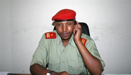Bosco Ntaganda talks on his mobile phone at his office in Goma, April 4, 2009. REUTERS/Paul Harera/Files