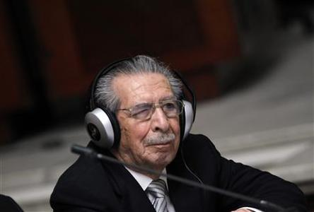 Former Guatemalan dictator Efrain Rios Montt uses headphones in the Supreme Court of Justice to hear testimonies against him, during the second day of session of his trial in Guatemala City, March 20, 2013. REUTERS/Jorge Dan Lopez