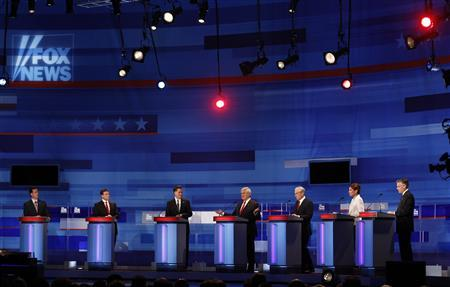 Republican presidential candidates (L-R) former U.S. Senator Rick Santorum (R-PA), Texas Governor Rick Perry, former Massachusetts Governor Mitt Romney, former U.S. Speaker of the House Newt Gingrich (R-GA), U.S. Representative Ron Paul (R-TX), U.S. Representative Michele Bachmann (R-MN), and former Governor of Utah Jon Huntsman attend the Republican Party presidential candidates debate as Gingrich speaks in Sioux City, Iowa, December 15, 2011. REUTERS/Jim Young
