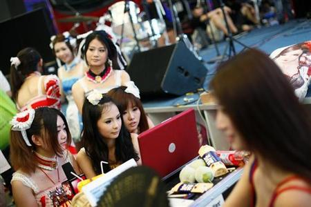 Girls wearing cosplay outfits take a break in between performances during the 8th annual China Digital Entertainment Expo and Conference (ChinaJoy) in Shanghai July 30, 2010. REUTERS/Aly Song/Files