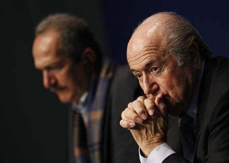 FIFA President Sepp Blatter (R) and Brazil's Minister of Sports Aldo Rebelo attend a news conference at the Home of FIFA in Zurich, March 19, 2013. REUTERS/Michael Buholzer
