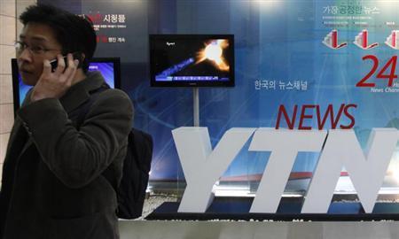 3月21日、韓国放送通信委員会は、同国の放送局や銀行のサーバーがサイバー攻撃を受けた事件で、発信元のIPアドレスが中国のものだったと発表した。写真は被害を受けたYTN本社。20日撮影(2013年 ロイター/Lee Jae-Won)
