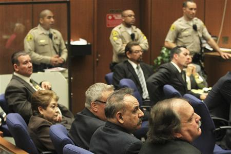 Five former Bell City elected officials, Victor Bello, Oscar Hernandez, George Cole, Teresa Jacobo (bottom R-L), and George Mirabal (top C) were found guilty of stealing public money by paying themselves extraordinary salaries, in a Los Angeles Superior courtroom March 20, 2013. REUTERS/Irfan Khan/POOL