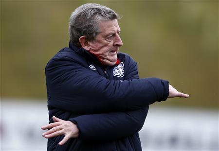 England manager Roy Hodgson stretches during a training session at the St George's Park training complex near Burton Upon Trent, central England, March 19, 2013. REUTERS/Darren Staples