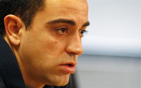 Barcelona's Xavi Hernandez speaks during a news conference at Ciutat Esportiva Joan Gamper in Sant Joan Despi, near Barcelona February 21, 2013. REUTERS/Gustau Nacarino/Files