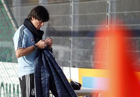 Germany's national soccer team head coach Joachim Loew attends a training session ahead of their 2014 World Cup qualifying soccer match against Kazakhstan in Frankfurt March 19, 2013. REUTERS/Lisi Niesner