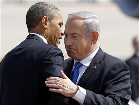 U.S. President Barack Obama hugs Israeli Prime Minister Benjamin Netanyahu at Ben Gurion International Airport Airport in Tel Aviv March 20, 2013. REUTERS/Jason Reed