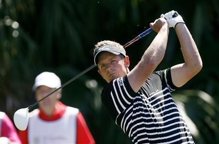 Britain's Luke Donald tees off on the 12th hole during first round play in the 2013 WGC-Cadillac Championship PGA golf tournament in Doral, Florida March 7, 2013. REUTERS/Andrew Innerarity