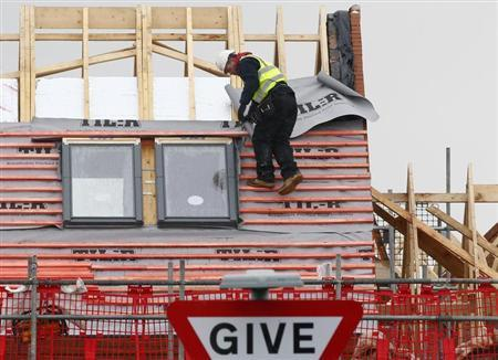 A construction worker climbs the roof of a new home on a housing development in Ashby-de-la-Zouch, central England, March 20, 2013. REUTERS/Darren Staples