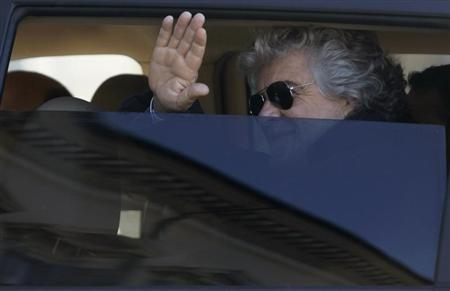 The anti-establishment 5-Star Movement former comic Beppe Grillo waves as he arrives at Quirinale palace in Rome March 21, 2013. REUTERS/Remo Casilli