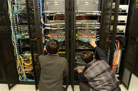 Employees of the Korean Broadcasting System (KBS) inspect a server to recover it at the company's main office in Seoul March 21, 2013 in this picture taken by KBS. REUTERS/KBS/Handout