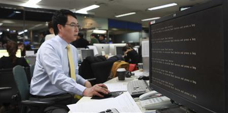 A computer is seen down after hacking at main office of broadcaster YTN in Seoul March 20, 2013. South Korean authorities were investigating a hacking attack that brought down the servers of three broadcasters, including YTN, and two major banks on Wednesday, and the army raised its alert level due to concerns of North Korean involvement. REUTERS/Handout/YTN