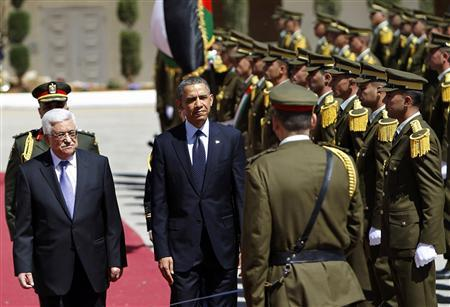 U.S. President Barack Obama (C) and Palestinian President Mahmoud Abbas (L) stand together after reviewing the honour guard during a welcoming ceremony in the West Bank city of Ramallah March 21, 2013. REUTERS/Ammar Awad
