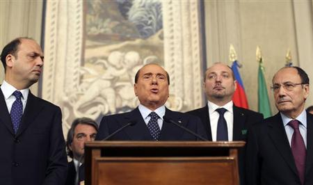 Italy's former Prime Minister Silvio Berlusconi (C) speaks after meeting with Italian President Giorgio Napolitano at Quirinale palace in Rome March 21, 2013. REUTERS/Alessandro Bianchi