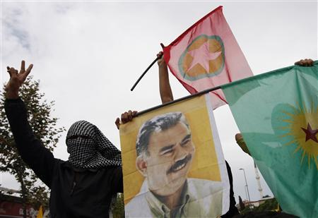 Masked demonstrators display a picture of jailed Kurdish rebel leader Abdullah Ocalan and PKK flags during a peace day rally in Istanbul in this September 1, 2009 file photo. REUTERS/Murad Sezer/Files