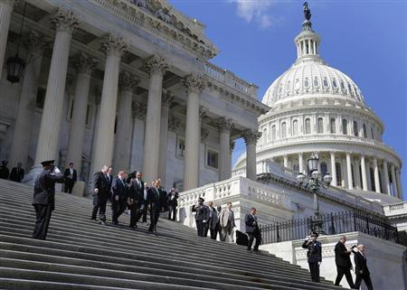 (L-R) U.S. Representative Peter King (R-NY), Irish Prime Minister Enda Kenny, U.S. President Barack Obama and U.S. House Speaker John Boehner (R-OH) walk down the U.S. Capitol steps together following a St. Patrick's Day lunch in Washington, March 19, 2013. REUTERS/Jonathan Ernst