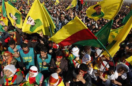 Demonstrators hold Kurdish flags and portraits of jailed Kurdistan Workers Party (PKK) leader Abdullah Ocalan during a gathering to celebrate Newroz in the southeastern Turkish city of Diyarbakir March 21, 2013. REUTERS/Umit Bektas
