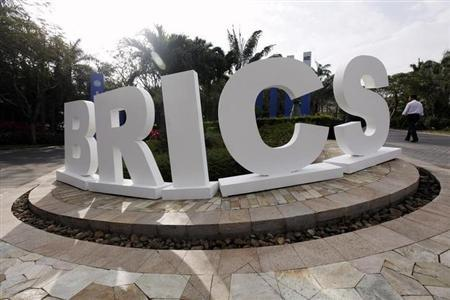 A man walks past a signage decoration for the BRICS summit outside Sheraton Hotel, the venue for the third BRICS summit in Sanya, Hainan province April 14, 2011. REUTERS/Jason Lee/Files
