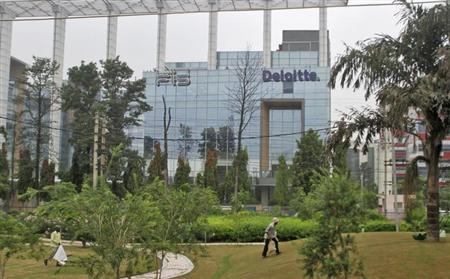The Deloitte Company logo is seen on a commercial tower at Gurgaon, on the outskirts of New Delhi August 9, 2012. REUTERS/Parivartan Sharma/Files