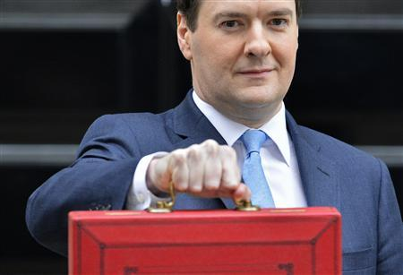 Chancellor George Osborne, holds up his budget case for the cameras as he stands outside number 11 Downing Street, before delivering his budget to the House of Commons, in central London March 20, 2013. REUTERS/Toby Melville