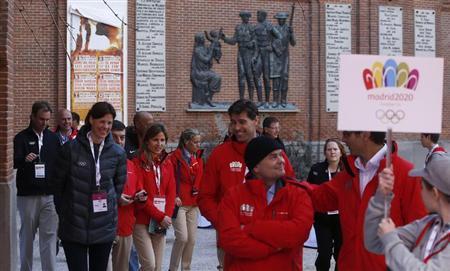 Members of the IOC walk near the Las Ventas bullring in Madrid March 18, 2013. REUTERS/Javier Barbancho