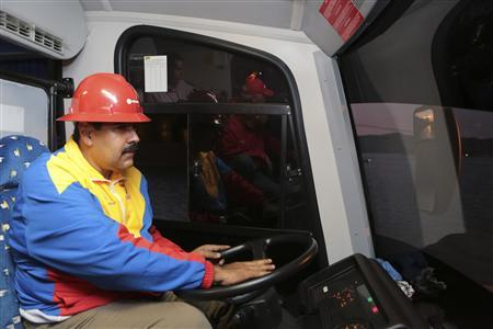 Venezuela's acting President Nicolas Maduro drives a vehicle during a meeting with oil workers in the port of Guaraguao in the state of Anzoategui in this handout picture provided by the Miraflores Palace on March 20, 2013. REUTERS/Miraflores Palace/Handout