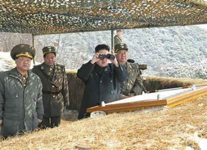 North Korean leader Kim Jong-Un (C) watches what KCNA said was a drill of drone planes assaulting targets and a firing drill of self-propelled flak rocket destroying ''enemy'' cruise missiles coming in attack in low altitude, conducted by the air force and air defence artillery units of the Korean People's Army in an undisclosed location in this picture released by the North's official KCNA news agency in Pyongyang March 20, 2013. KCNA said this picture was taken on March 20, 2013. REUTERS/KCNA