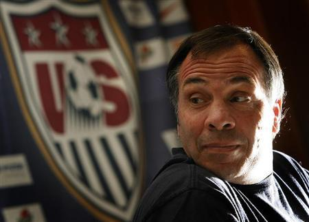 Former United States national soccer team coach Bruce Arena addresses a World Cup news conference in Hamburg in this June 23, 2006 file photo. REUTERS/Christian Charisius (GERMANY) - RTR1ES9P
