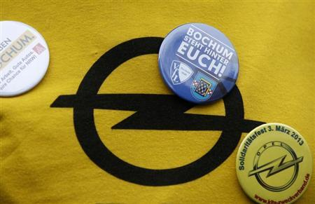Buttons are pinned near an Opel logo on a t-shirt at a solidarity festival for carmaker Opel in Bochum March 3, 2013. REUTERS/Ina Fassbender