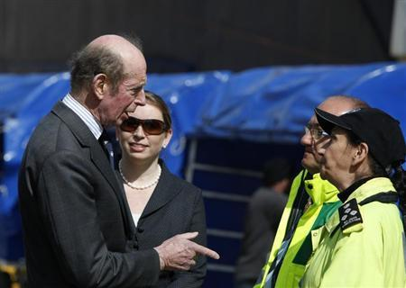 The Duke of Kent (L) talks to British High Commissioner to Malta Louise Stanton (2nd L), Maltese Parliamentary Secretary for Health Mario Galea (2nd R) and a paramedic while waiting to greet 15 British passengers disembarking from the German-chartered ferry Santorini Express after it berthed with some 500 oil workers of various nationalities from the Benghazi area of Libya on board in Valletta's Grand Harbour March 1, 2011. REUTERS/Darrin Zammit Lupi