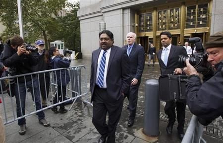 alleon hedge fund founder Raj Rajaratnam departs Manhattan Federal Court after his sentencing in New York October 13, 2011. REUTERS/Lucas Jackson/Files