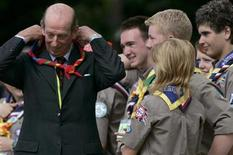 Britain's Prince Edward, Duke of Kent, dons a neckerchief presented to him by scouts during the centenary celebrations of scouting during the 21st World Scout Jamboree at Highlands Park near Chelmsford in south eastern England July 28, 2007. REUTERS/Luke MacGregor
