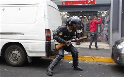 Venezuelan police fire tear gas during clash ahead of...