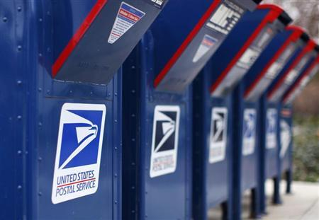 A view shows U.S. postal service mail boxes at a post office in Encinitas, California February 6, 2013. REUTERS/Mike Blake