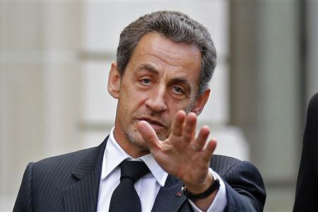 Former French President Nicolas Sarkozy reacts as he leaves his car in Paris November 26, 2012 after a lunch meeting with his former Prime Minister Francois Fillon to discuss the UMP political party's crisis. REUTERS/Benoit Tessier