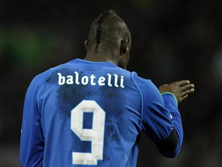 Italy's Mario Balotelli gestures during their international friendly soccer match against Brazil at the Stade de Geneve in Geneva March 21, 2013. REUTERS/Denis Balibouse