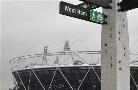 A sign in front of the 2012 Olympics stadium points towards West Ham, London February 10, 2011. REUTERS/Toby Melville