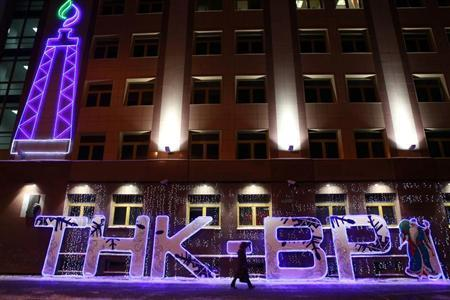 An illuminated sign is displayed in front of the local office of TNK-BP company in the Siberian city of Tyumen, January 17, 2013. REUTERS/Eduard Korniyenko