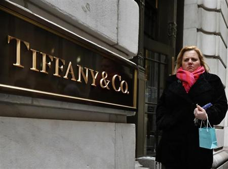 A woman exits the Tiffany & Co. store on Wall St. in New York, March 18, 2013. REUTERS/Brendan McDermid