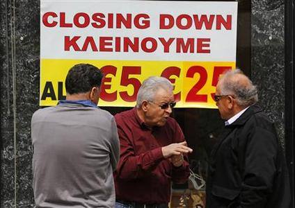 Cypriot shop owners chat about the dire financial situation of their country in Nicosia's shopping district March 22, 2013. REUTERS/Yannis Behrakis