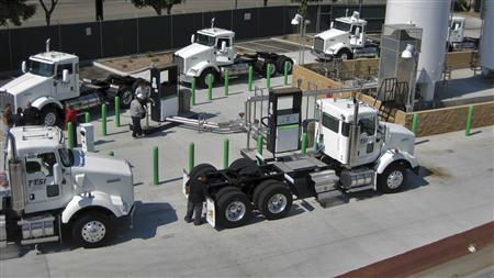 TTSI trucks are pictured refueling with liquefied natural gas (LNG) in Port of Los Angeles in San Pedro, California in this May 29, 2008 photograph. REUTERS/Westport Innovations Inc./Handout