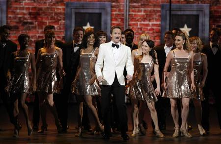 Actor Neil Patrick Harris performs with the cast of 'The Book of Mormon' during the American Theatre Wing's 66th annual Tony Awards in New York June 10, 2012. REUTERS/Lucas Jackson