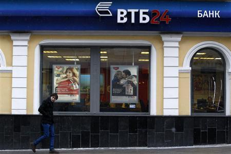 A man walks past an office of VTB Bank in central Moscow March 18, 2013. REUTERS/Sergei Karpukhin