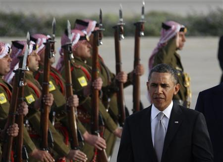 U.S. President Barack Obama is greeted by Bedouin Jordanian honour guards upon his arrival at Amman airport, March 22, 2013. REUTERS/Ali Jarekji