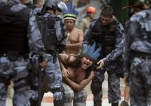 A native Indian reacts as military police officers evict a native Indian community living at the Brazilian Indian Museum in Rio de Janeiro March 22, 2013. REUTERS/Ricardo Moraes
