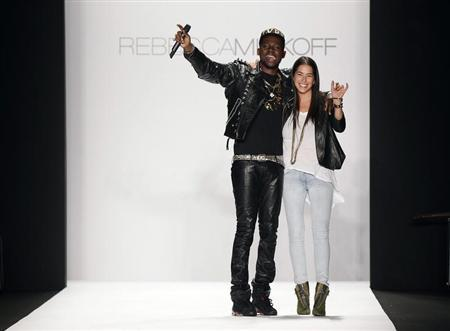Designer Rebecca Minkoff smiles and waves with a musician after presenting her Fall/Winter 2012 collection during New York Fashion Week February 10, 2012. REUTERS/Lucas Jackson