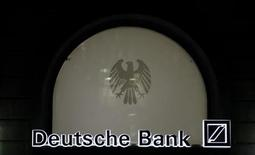 The logo of Germany's largest business bank, Deutsche Bank, is illuminated at the bank's original headquarters in Frankfurt January 31, 2012. REUTERS/Kai Pfaffenbach