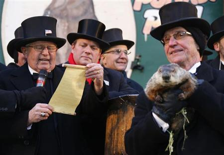 Groundhog co-handler Ron Ploucha (R) holds Punxsutawney Phil as the Groundhog Club's Bob Roberts (L) reads the famous groundhog's annual weather prediction on Gobbler's Knob in Punxsutawney, Pennsylvania, on the 127th Groundhog Day, February 2, 2013. REUTERS/Jason Cohn