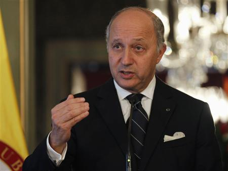 France's Foreign Affairs Minister Laurent Fabius attends a news conference after a bilateral meeting at San Carlos Palace in Bogota February 25, 2013. REUTERS/John Vizcaino