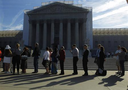 People line up for admission at the U.S. Supreme Court in Washington October 1, 2012. REUTERS/Gary Cameron